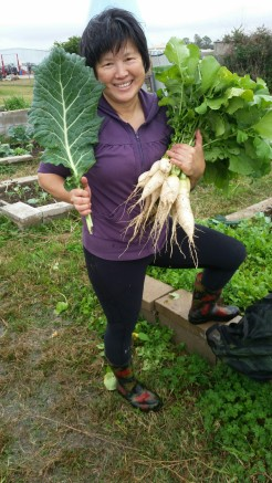 Siok Hong Chen-Sabot shows off her giant radishes